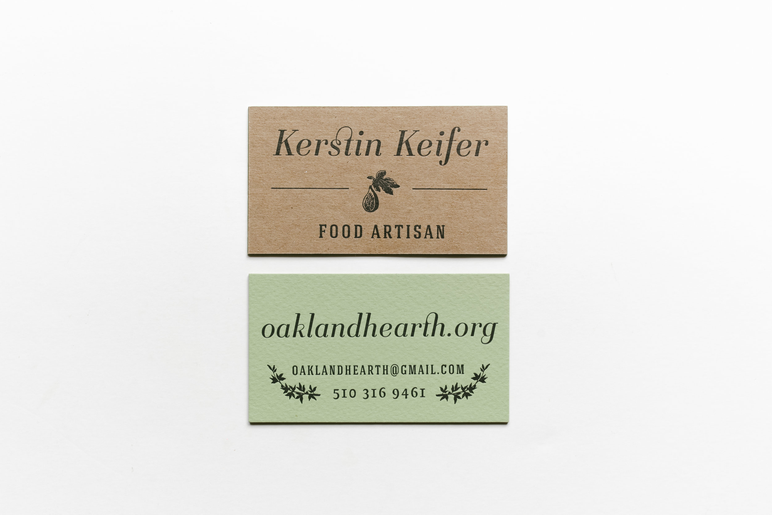 Original letterpress double-sided business card with kraft chipboard and sage green paper.
