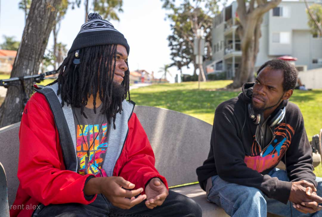 "Winston (Redondo Beach, CA.) shares his perspectives with a friend at a public park concerning two recent violent incidents resulting in death between a black male and police enforcement.  Both scenes were caught on video.   The April 4 shooting death of Walter Scott in South Carolina, involving white law enforcement officer, Michael Slager has caught national headlines and widespread discussion of racism.   The second case in discussion occured in downtown Los Angeles, March 1, 2015 involving  Charly ""Africa"" Leundeu Keunang a, a homeless black male on Skid Row and multiple officers.  Police have said Keunanga had robbed and assaulted another Skid Row male. Arriving at the scene, a rookie officer's holstered pistol was grabed, prompting three others to fire."
