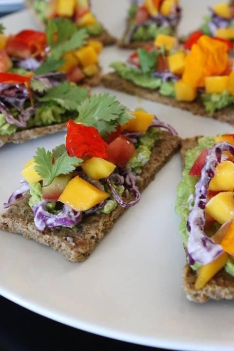 Hawaiian Toast. Raw Almond Bread. Avocado. Purple Cabbage. Mango Salsa. Herbs. Edible Flowers. Cashew Cream.