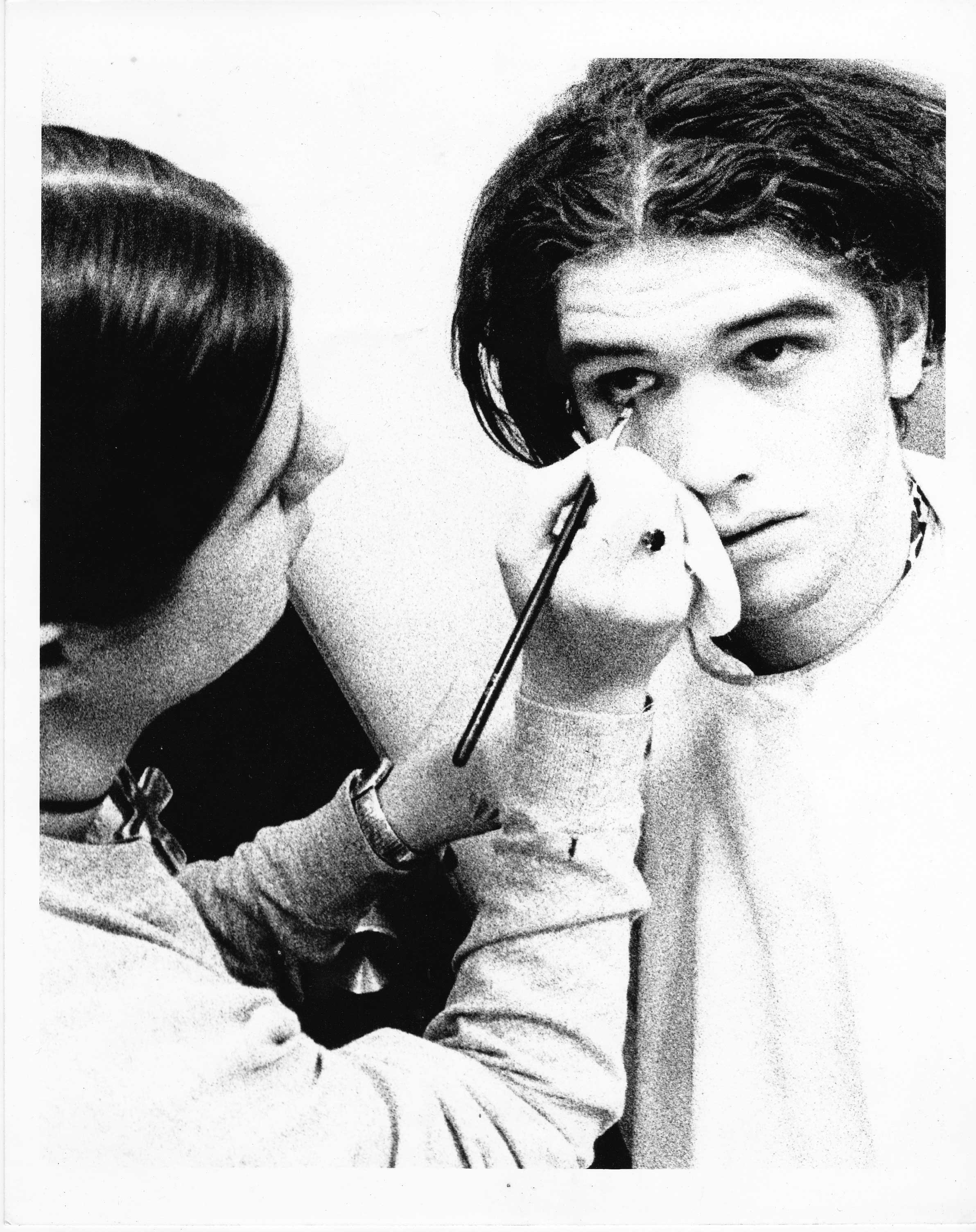 Makeup artist Suzanne Styche applying Torben Tilly.