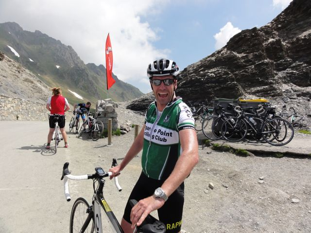 Aaron looks pleased to have made the top of Col du Tourmalet!