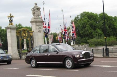 The queen is in this car! She drove right by us! Very cool!