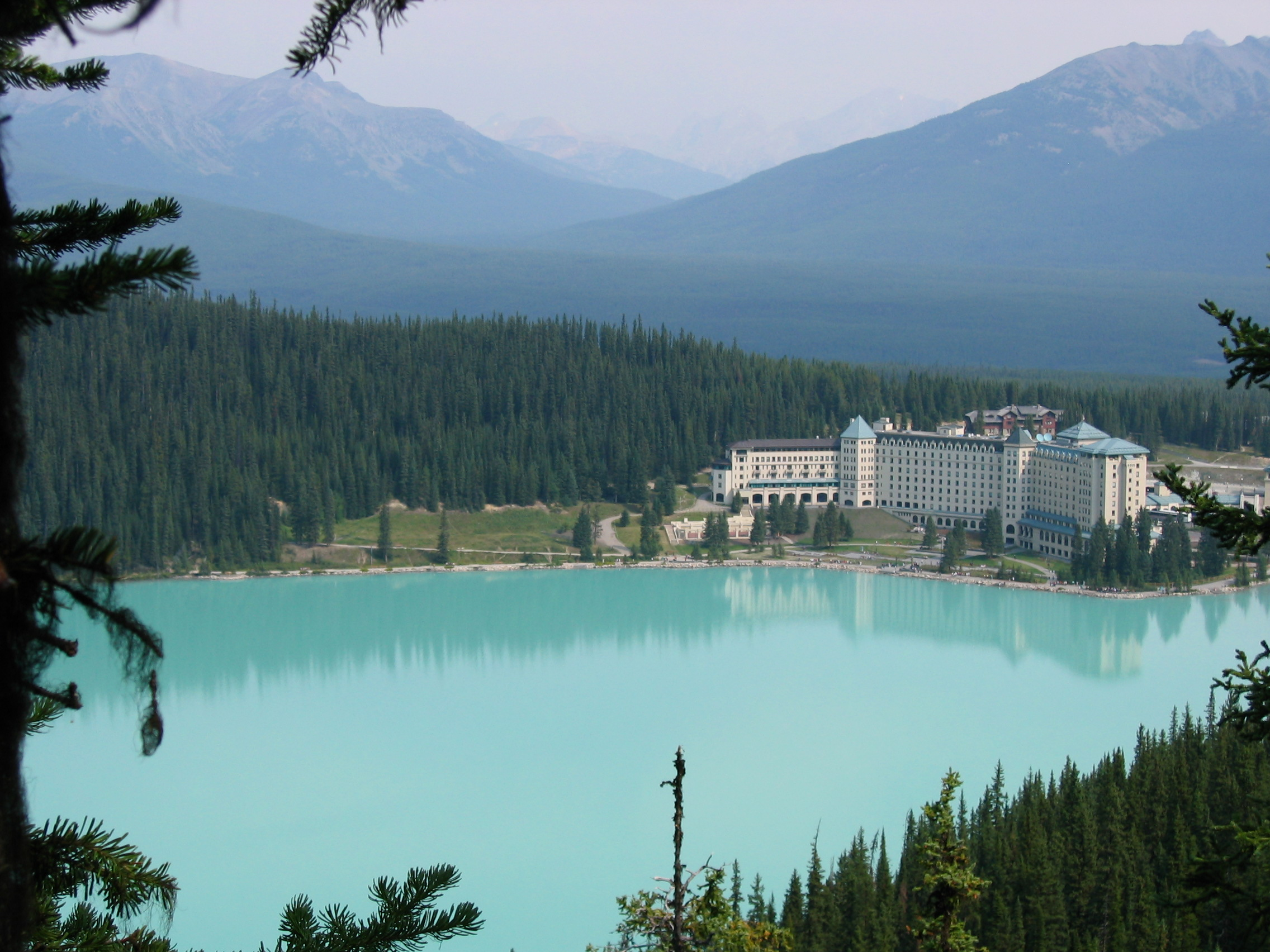 """The Chateau Lake Louise, where we stayed. I LOVED this place and would describe the atmosphere as """"comfortable elegance."""" Plus, walking out the back door of the hotel feels like stepping into a postcard."""