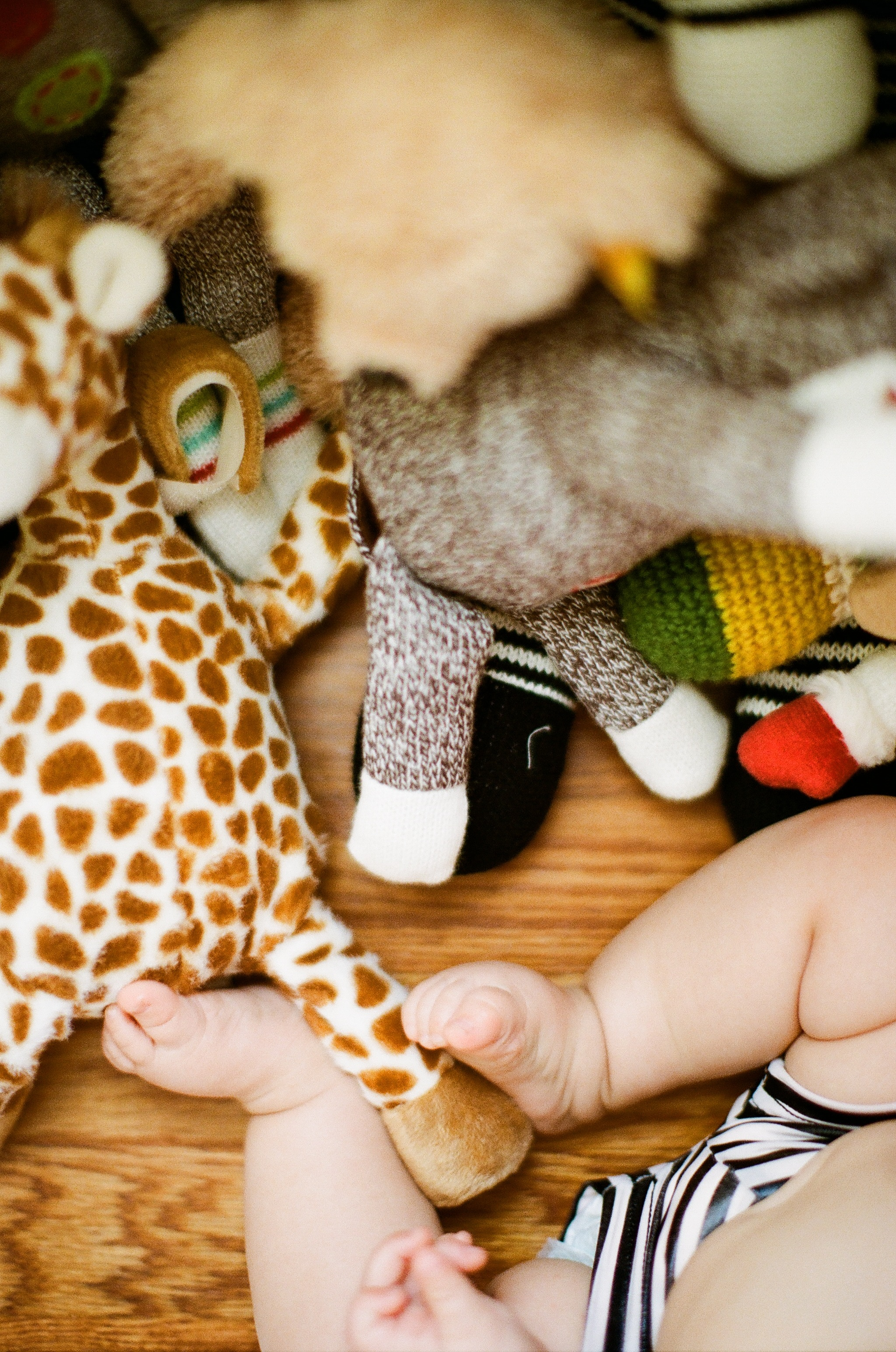 Baby was playing with her toys directly under the window so there was plenty of available light. 5 Tips for Taking better pictures of your kids | Lily Glass Photography