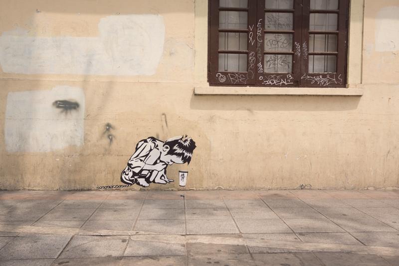 Graffiti of a child beggar.