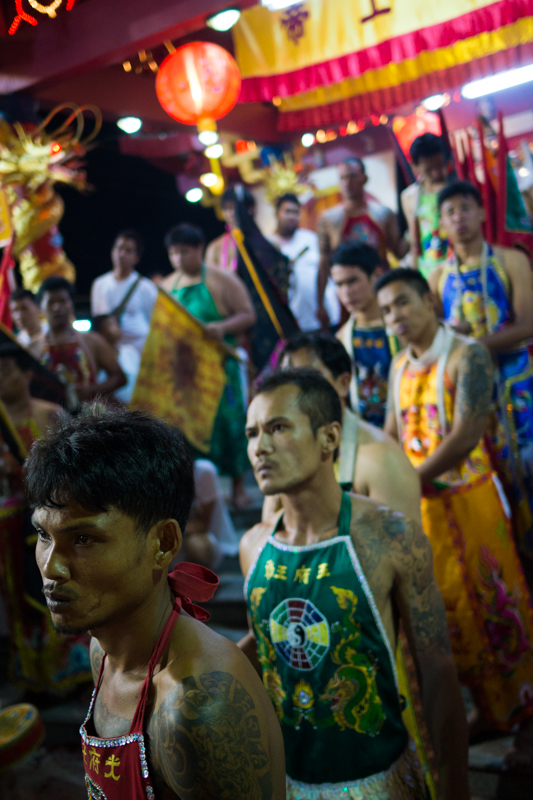 Warriors line up to receive blessings at a Chinese shrine in Phuket, Thailand.