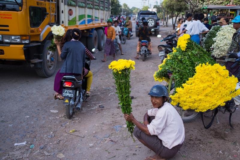 Flower seller in busy Mandalay.
