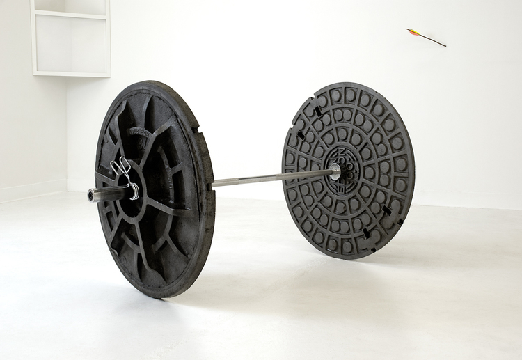Nick Darmstaedter  600 LBS  2010  Stainless steel bar, stolen cast iron man hole covers  Dimensions variable