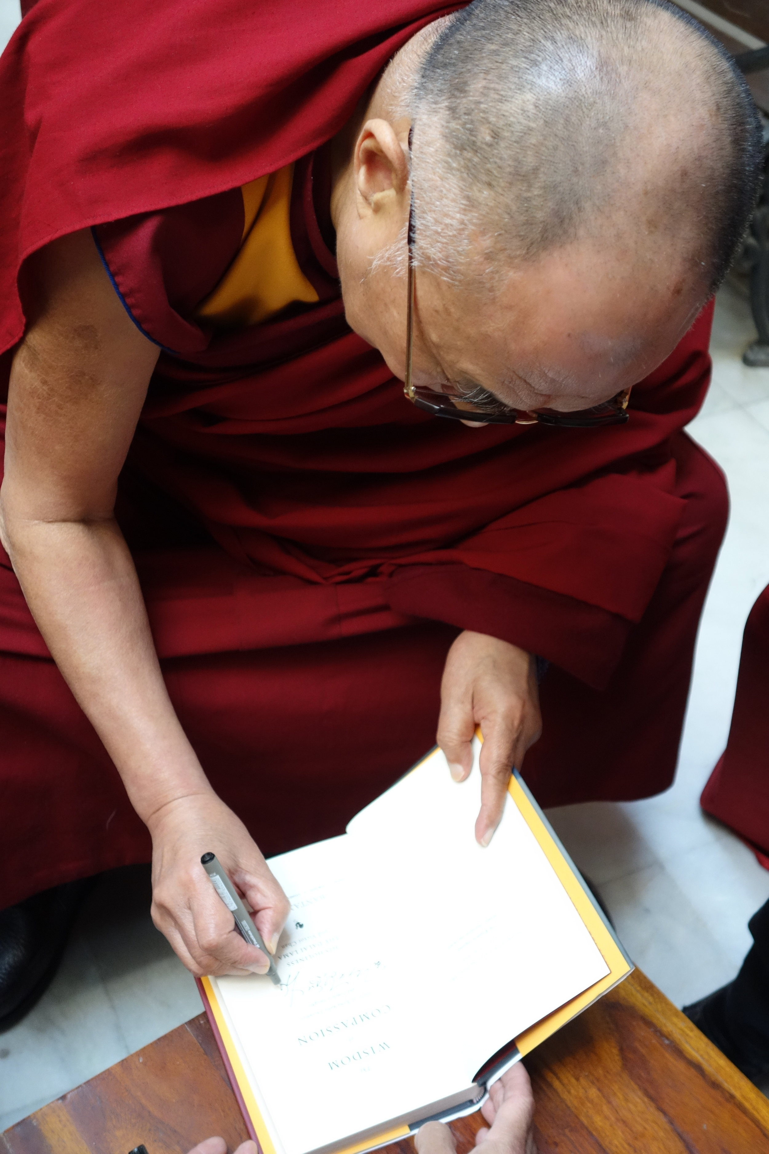Signing the Wisdom of Compassion by the Dalai Lama and Victor Chan