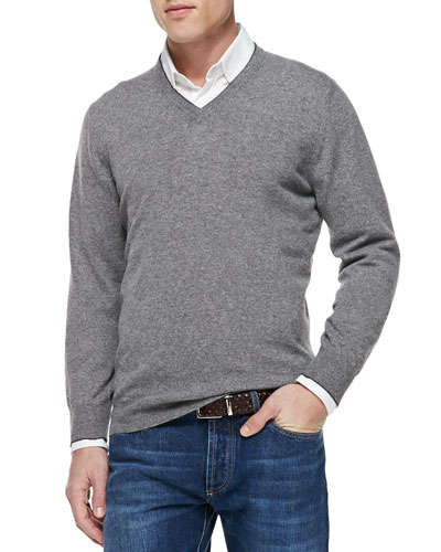 The basics: If you're not comfortable in a suit and don't want to pair a blazer with jeans, simple V-neck sweaters are great layers to dress up a shirt.