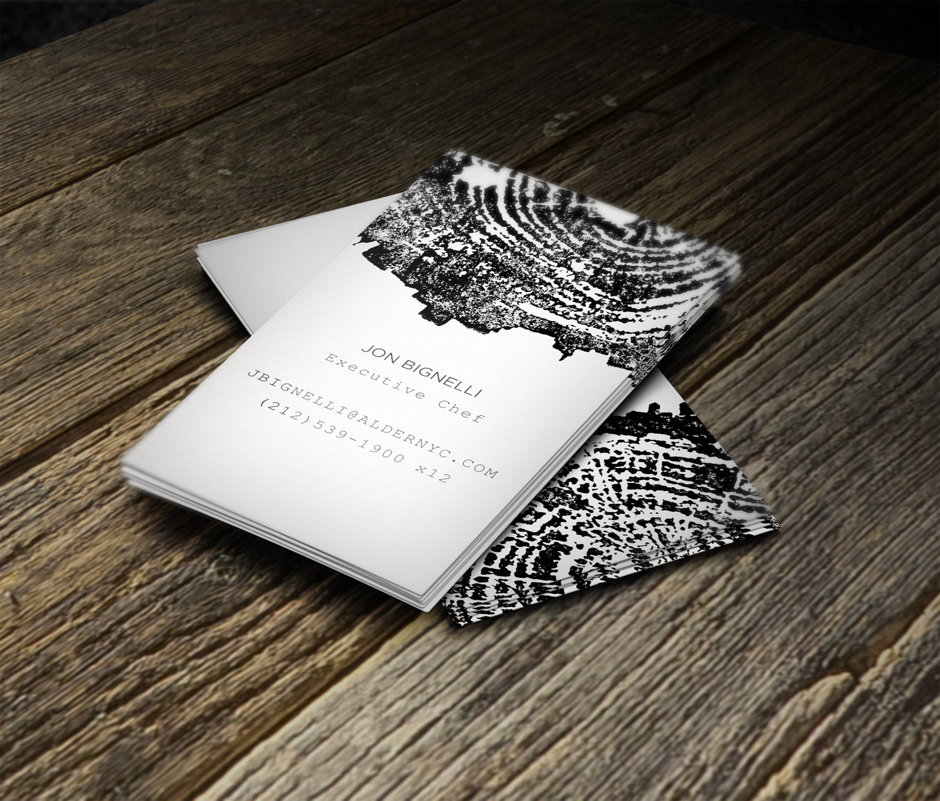 Business cards - The business cards are elegant black and white with sparse typography.