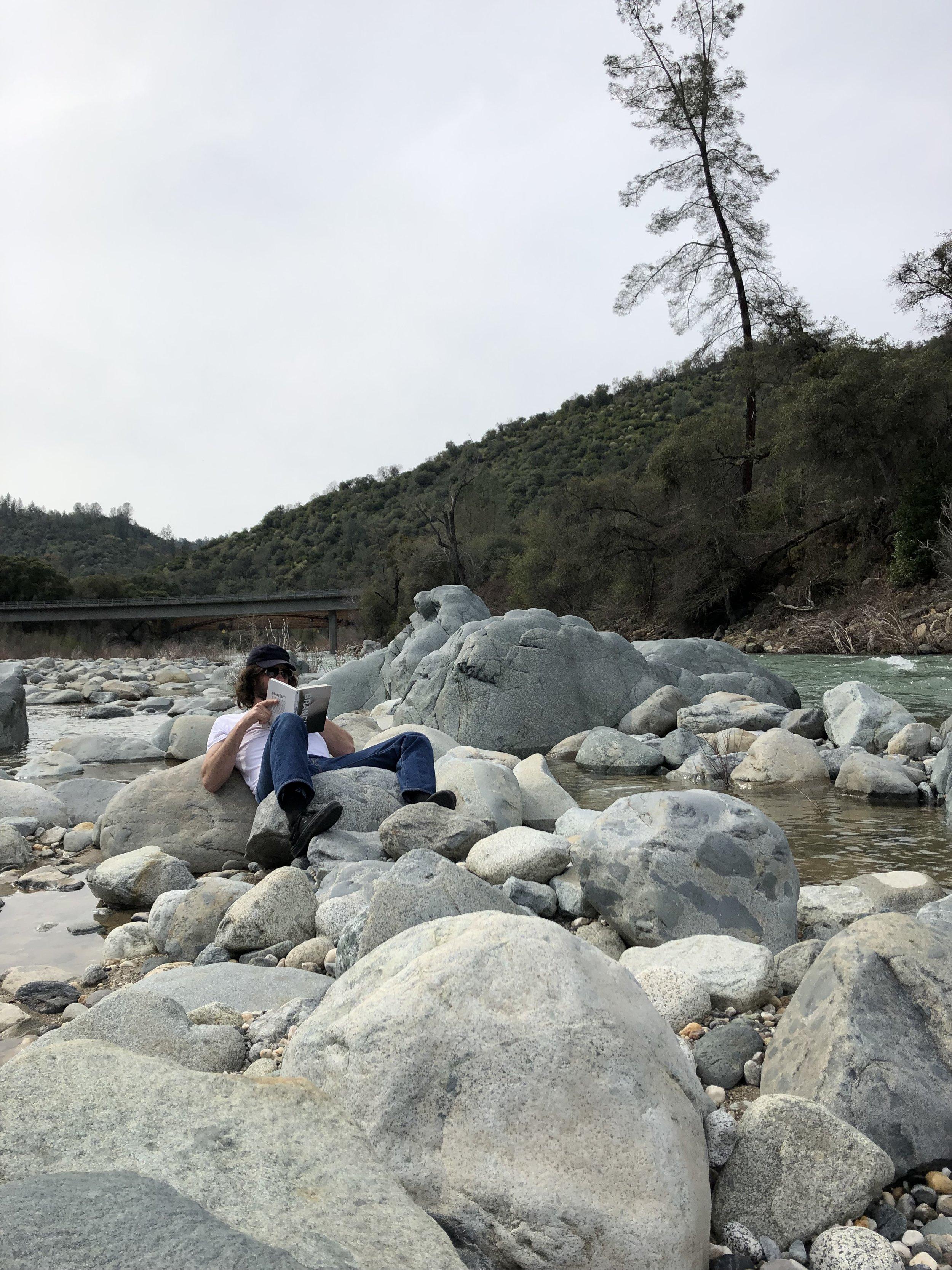 reader_at_yuba_river.jpeg
