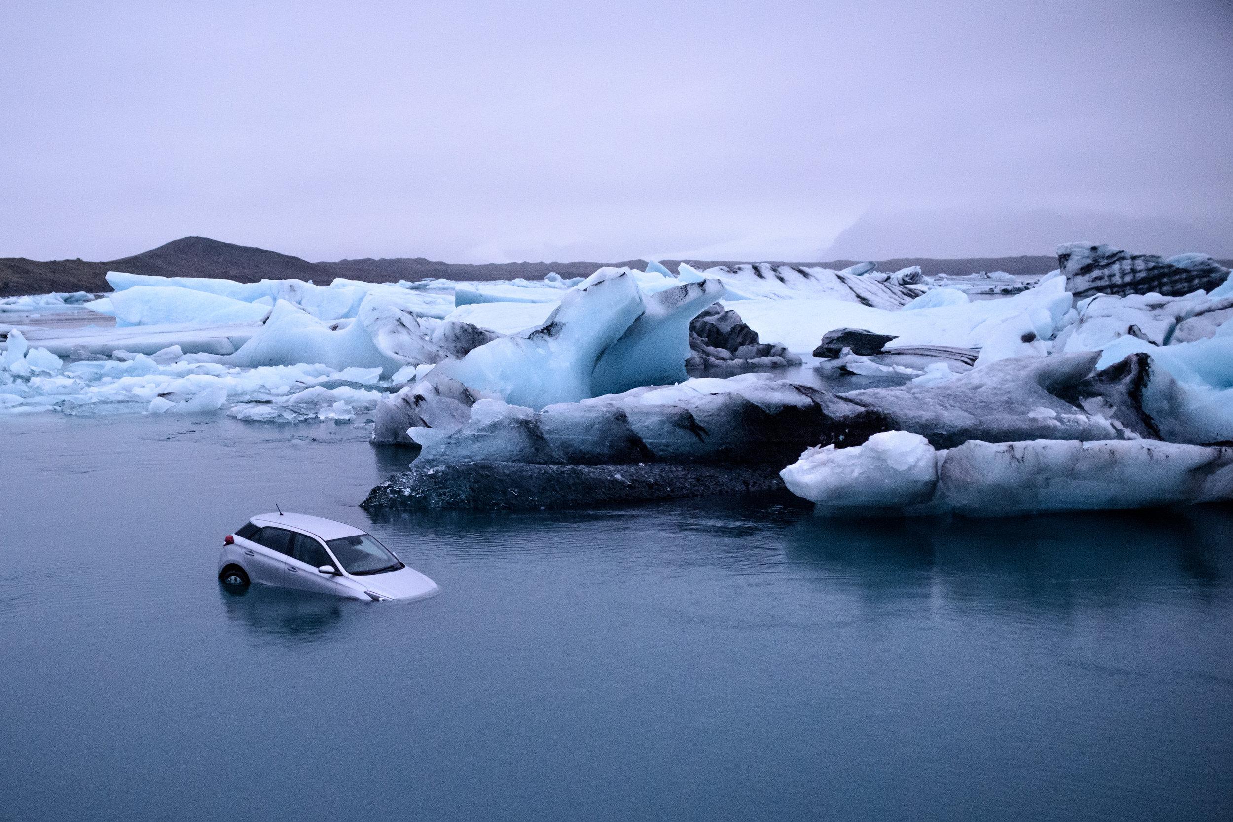 A car sinks into Jökulsárlón glacial lagoon, Iceland