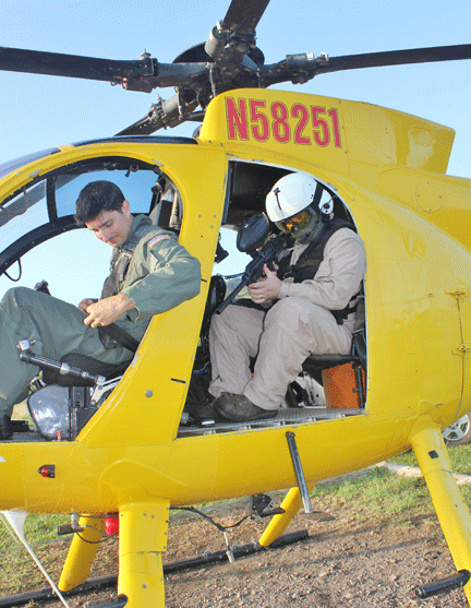 Figure 6. HBT applicator Dr. James Leary in position behind pilot prior to takeoff for surveillance mission.  Photo by C. Duncan.