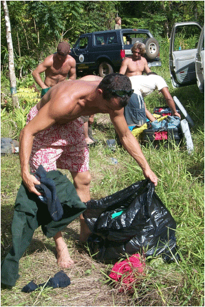 Figure 10. Strict sanitation and decontamination protocols are followed by ground crews to prevent movement of seed from miconia-infested areas.  Photo courtesy of Jeremy Gooding.