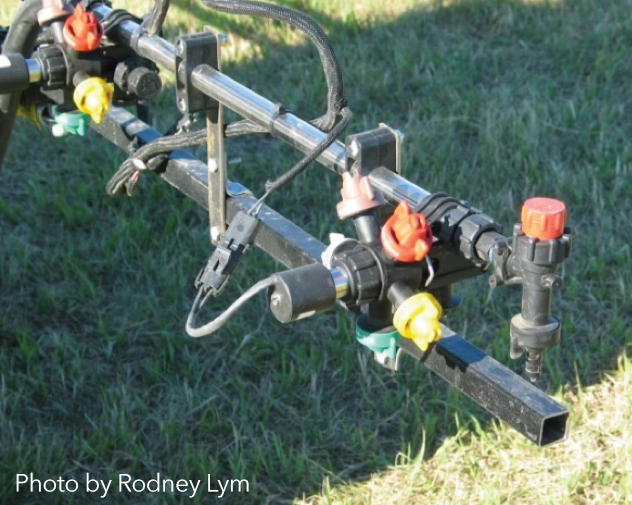 Figure 1:  Close-up of pulse width modulating nozzles for applying the herbicide solution at various droplet sizes. Photo by Rodney Lym.