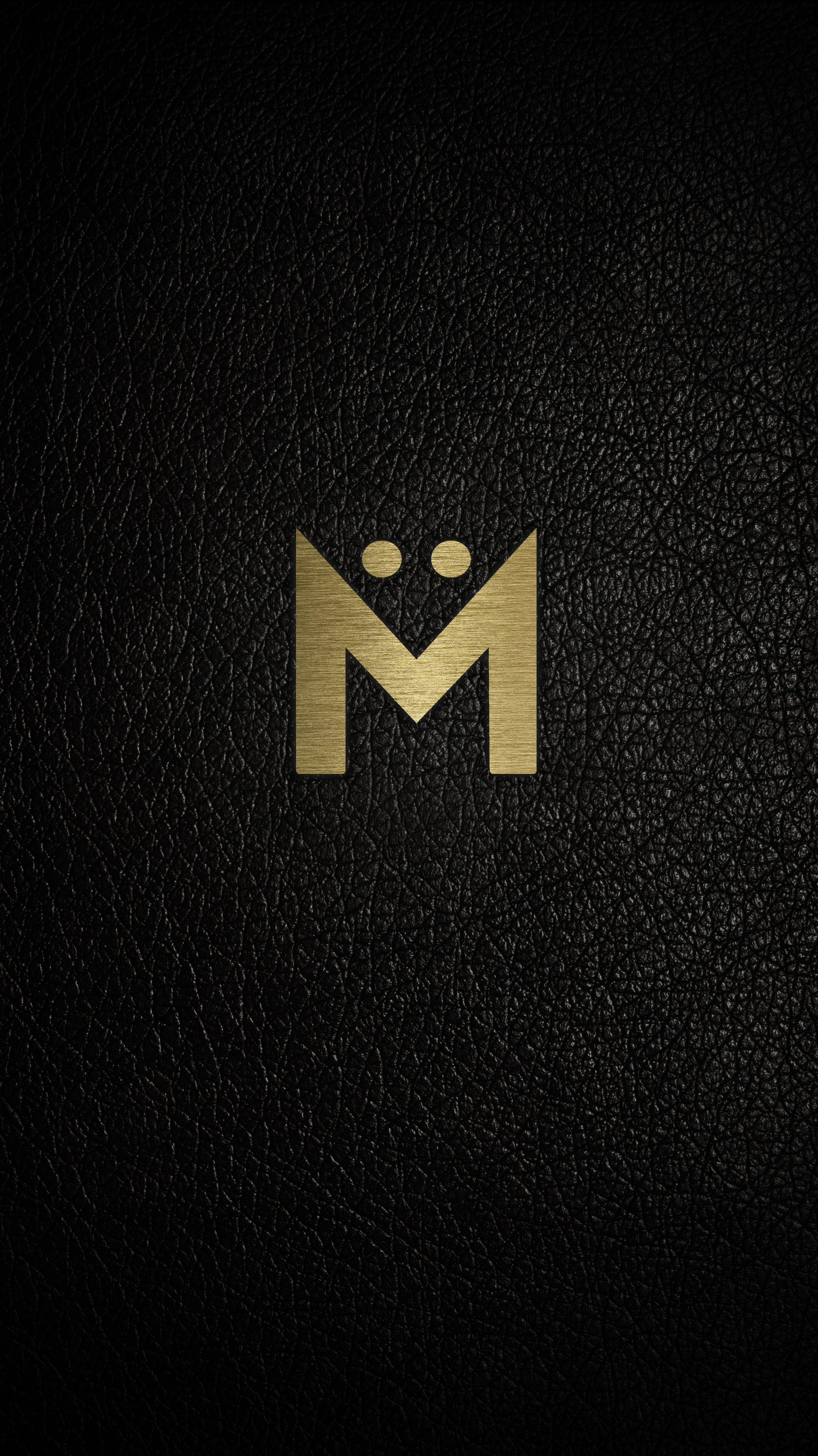 - Logo in Gold positioned on leather.