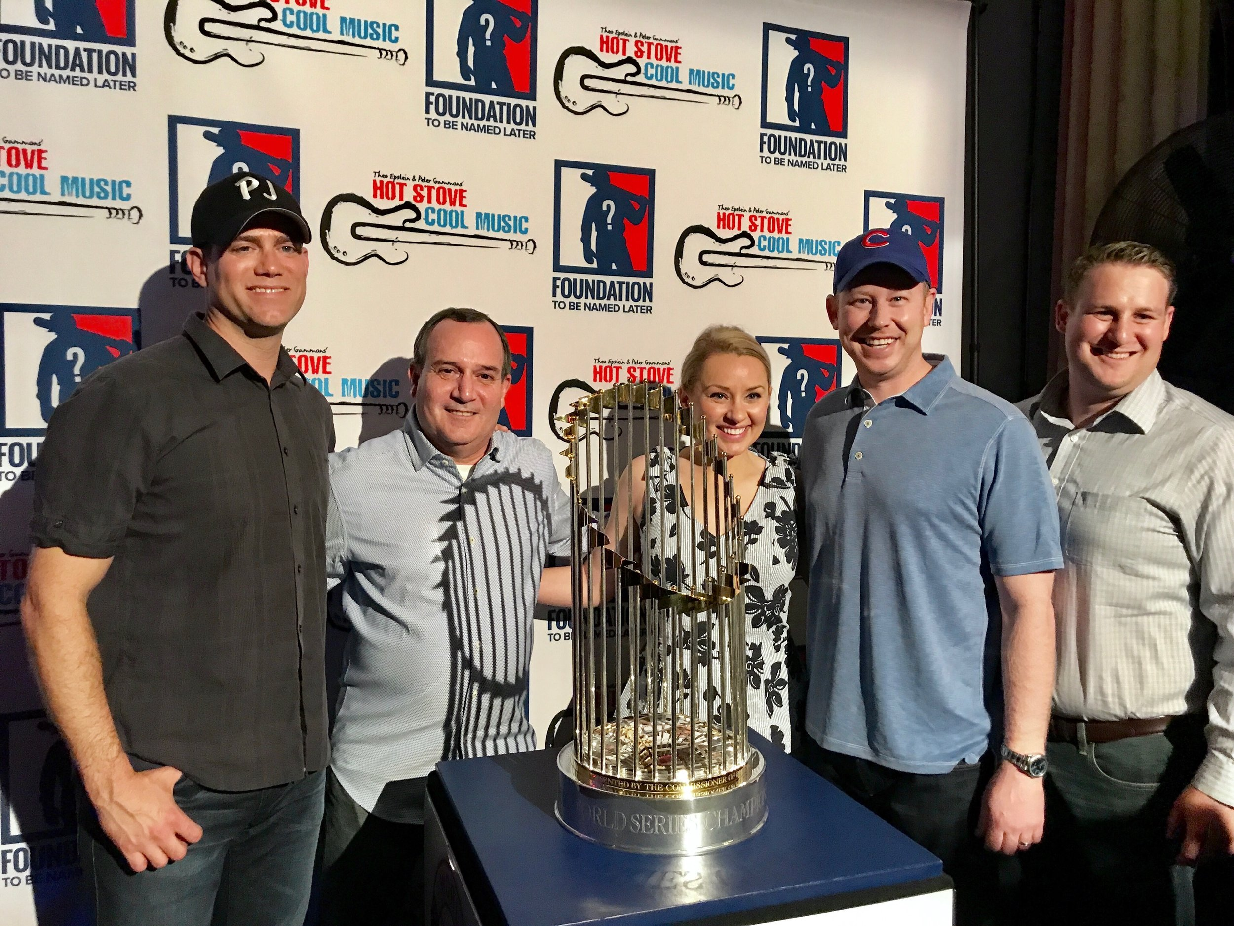 Athletes On The Move team with Cubs GM Theo Epstein with Cubs World Series Trophy.