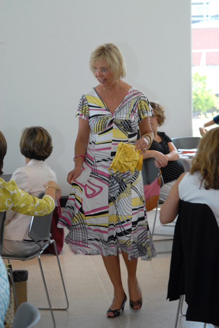 Board Member Carol Petersen modeling the latest fashions from Vagabondia.