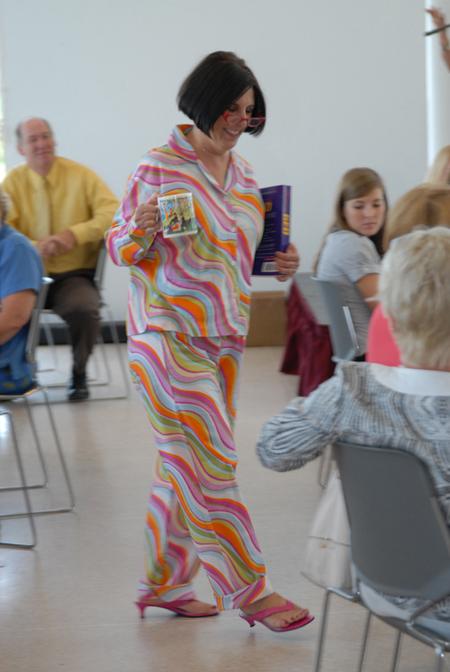 Ross Learning Center Program Director Lynn Moore shows off cozy sleepwear from Bliss.