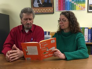 - Ralph, a Friends of Literacy student reading a book with Friends of Literacy Volunteer, Sydney