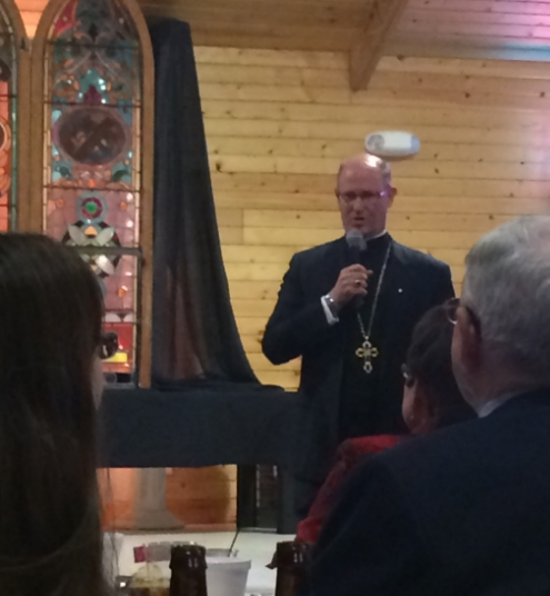 Bishop Conley addresses those at the dinner.