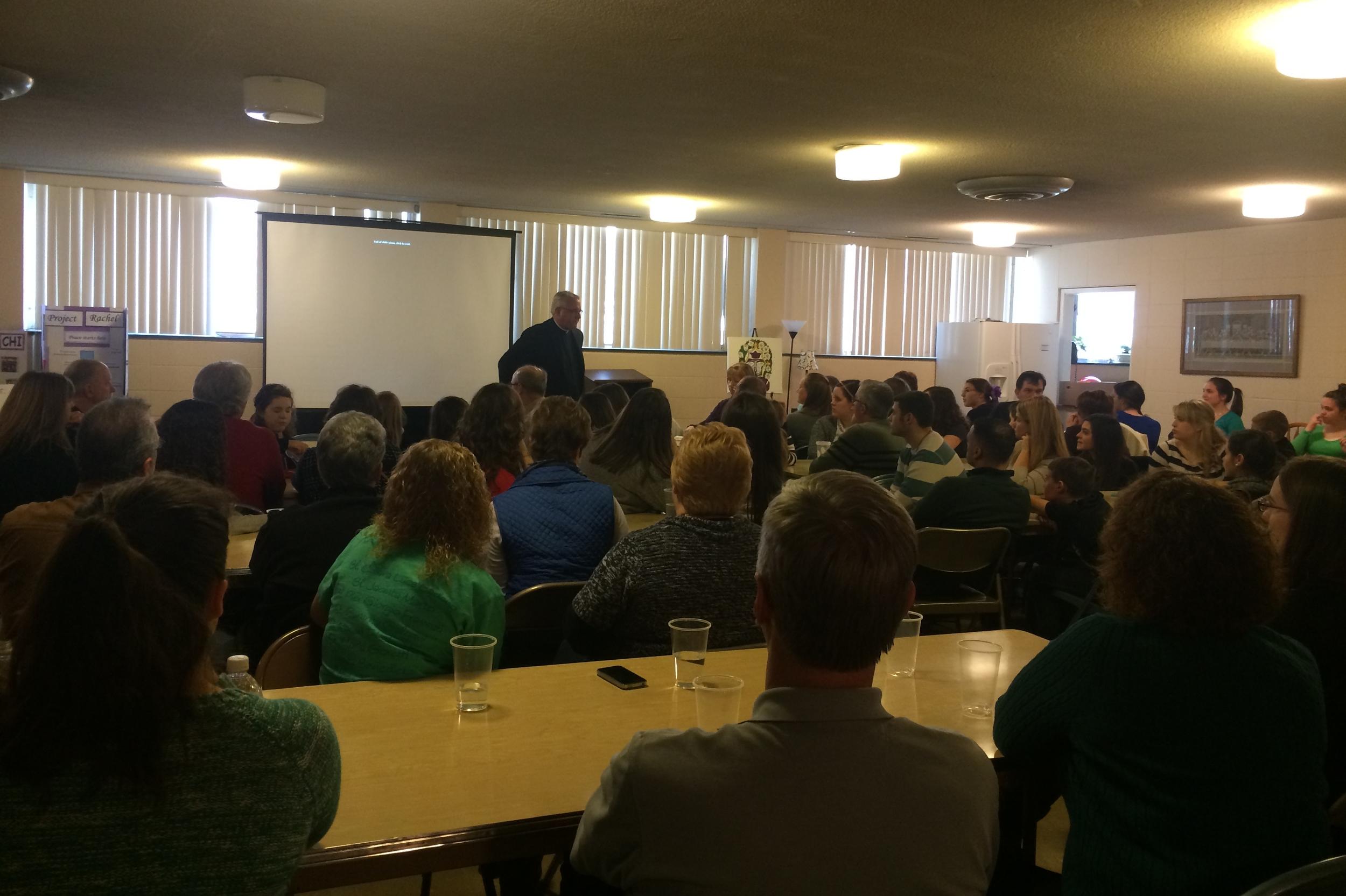 Fr. Robert Matya addressing the sorority members and families at the potluck.