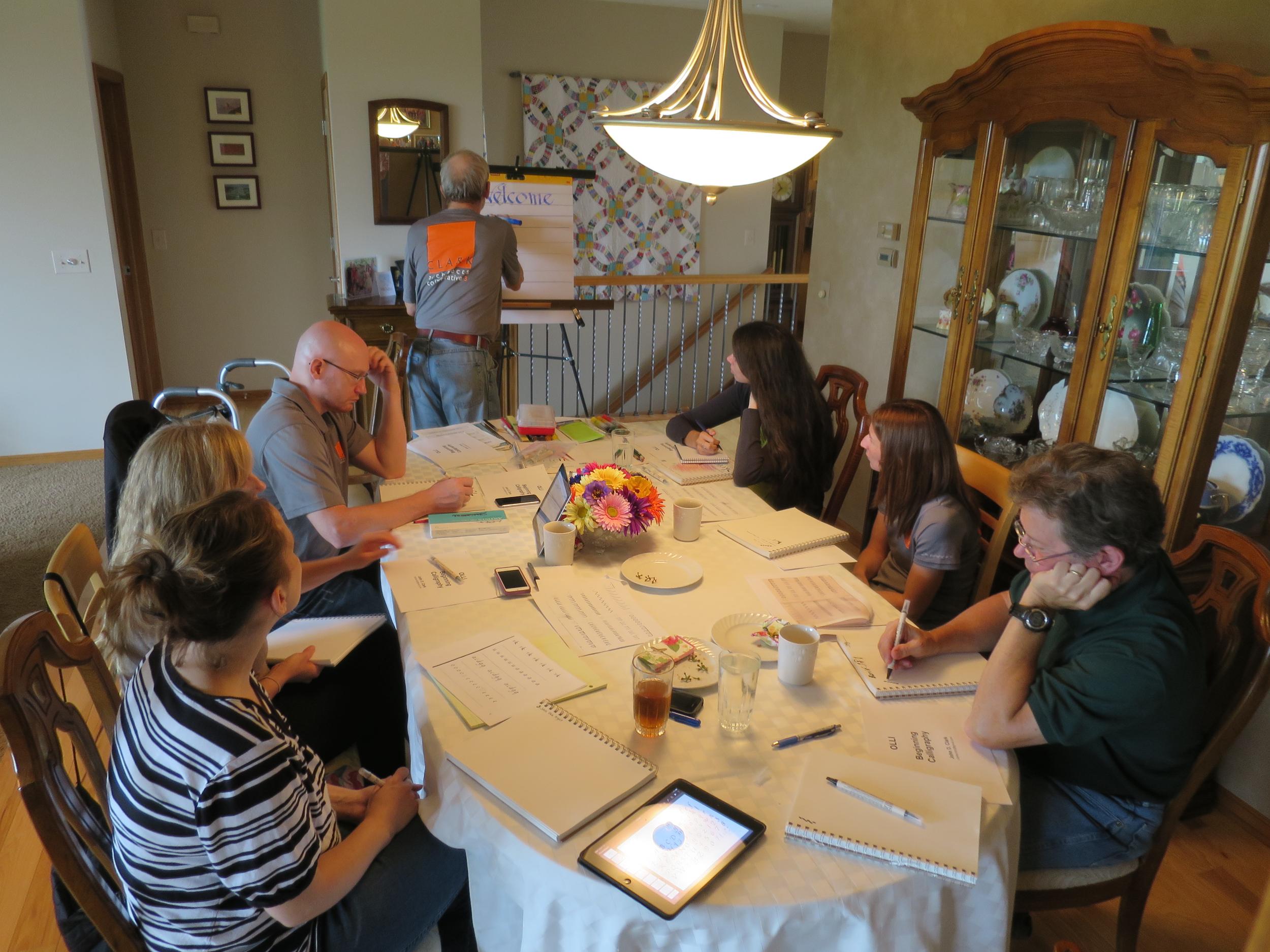 CALLIGRAPHY:  John Clark instructs the Clark staff