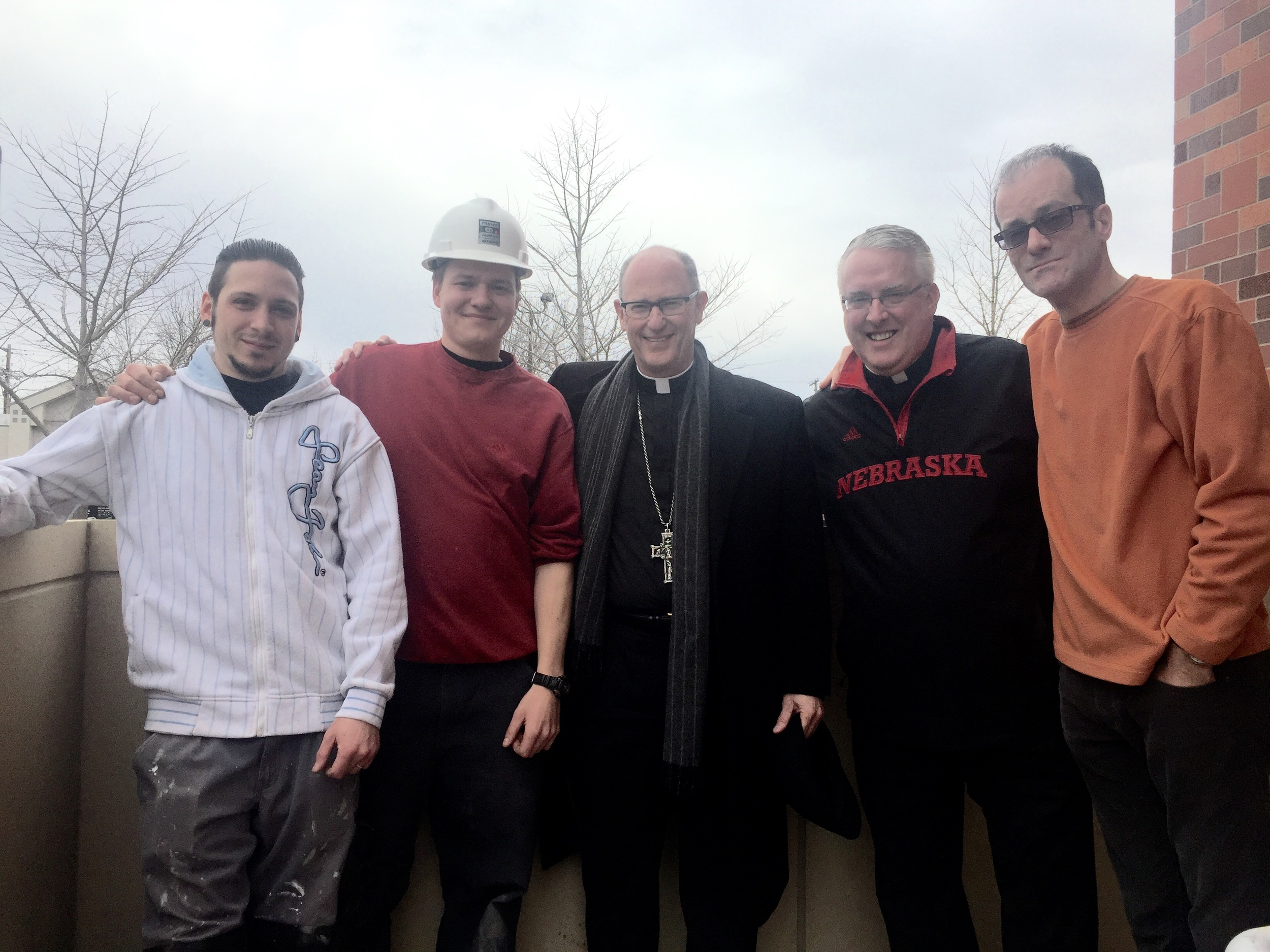 Bishop Conley stopped by to see the installation process
