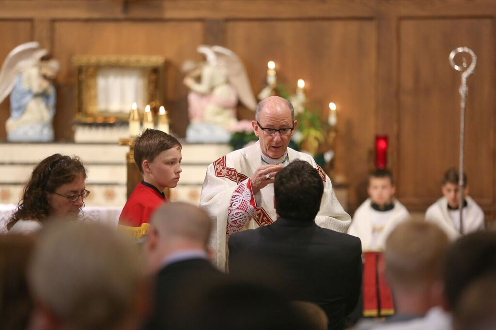 Distributing Holy Communion at the reconstructed communion rail