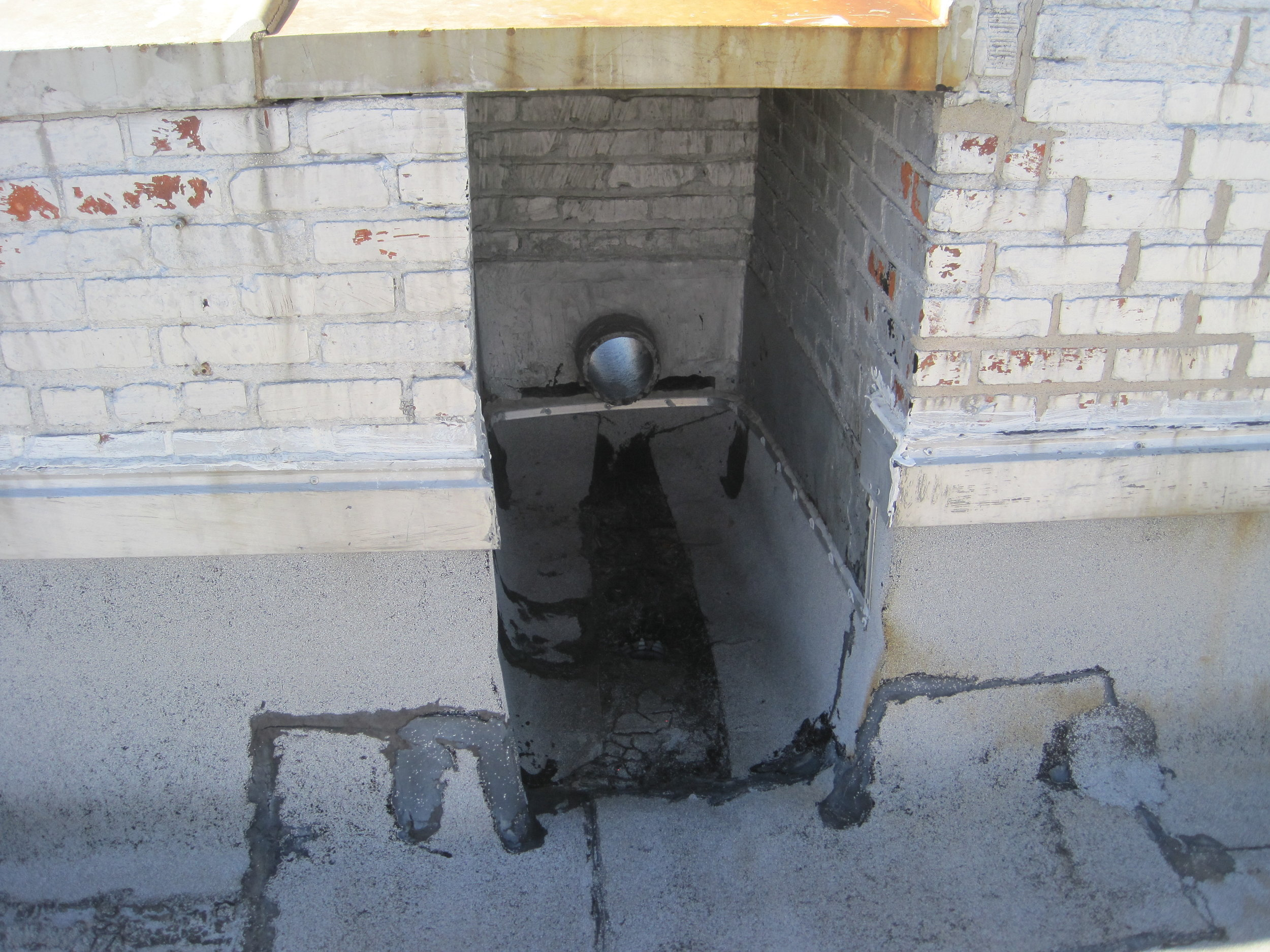 Answer: a roof overflow drain