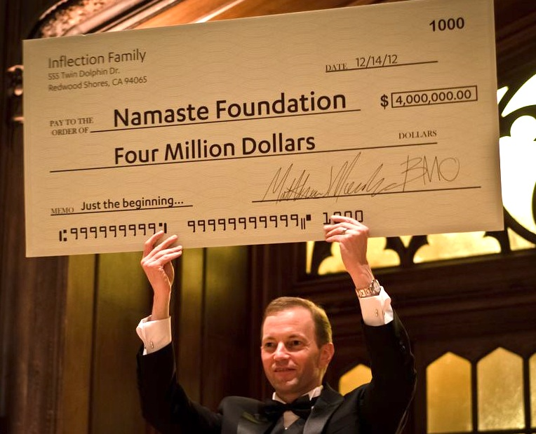 Andrew Cope, Senior Development Officer for the Silicon Valley Community Foundation, displays the initial grant for Namaste Foundation.