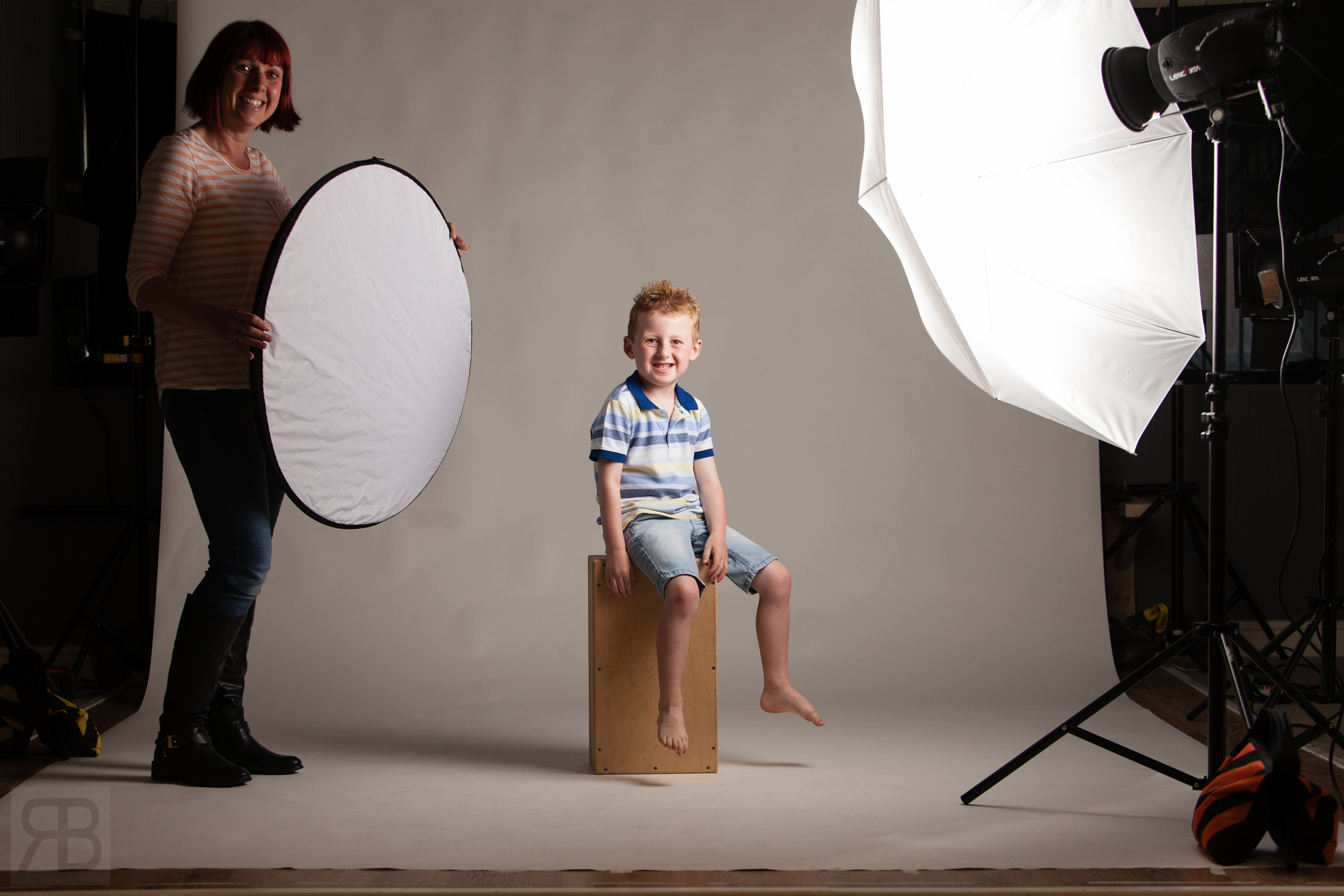 Esther helping out holding a reflector.
