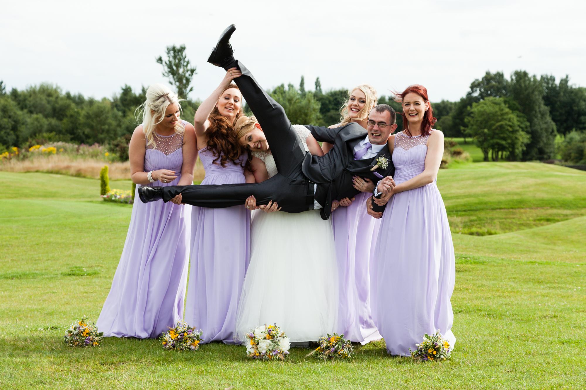 Bride, Groom and Bridesmaids at a wedding.