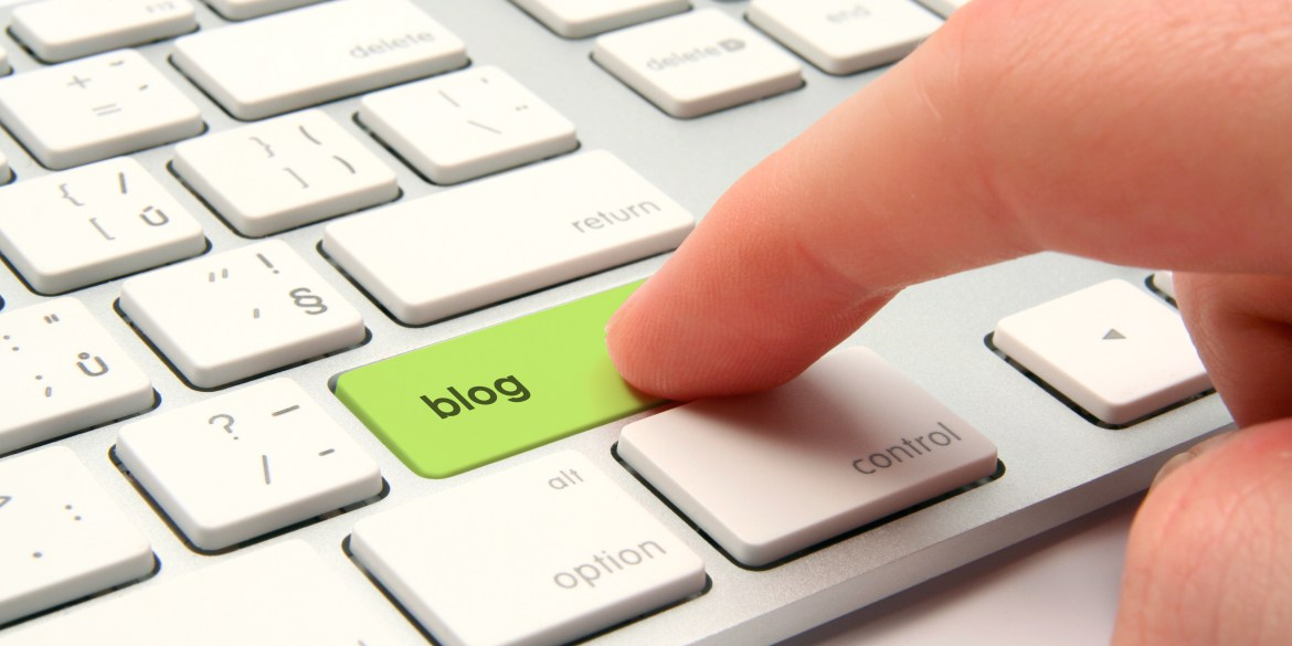 "[feature image shows laptop keyboard with person's finger hovering over the key ""blog""  via ]"