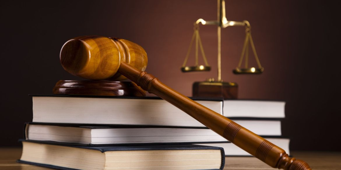 [feature image shows gavel on top of stack of books    via   ]