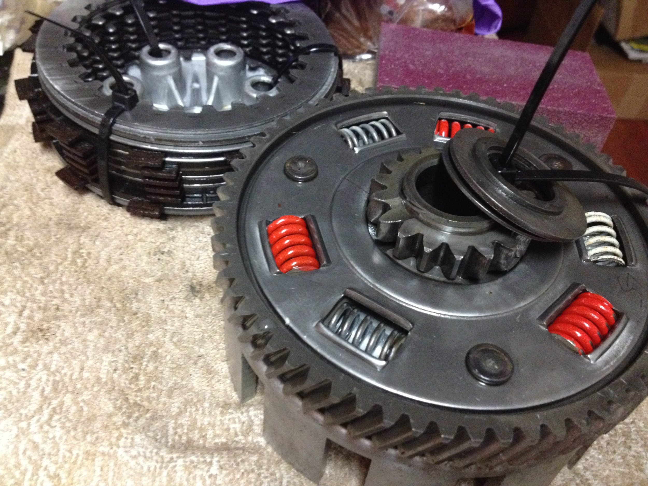 Clutch discs in background ziptied, clutch baskets/bearings in front