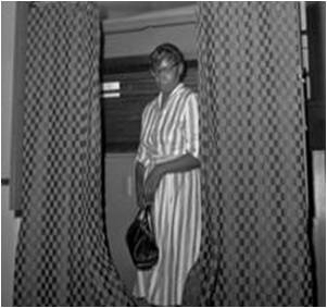Mary E. Johnson, shown as she proudly votes for the first time on July 28, 1962, the first African Americans to vote in East Carroll since the 1800's. -