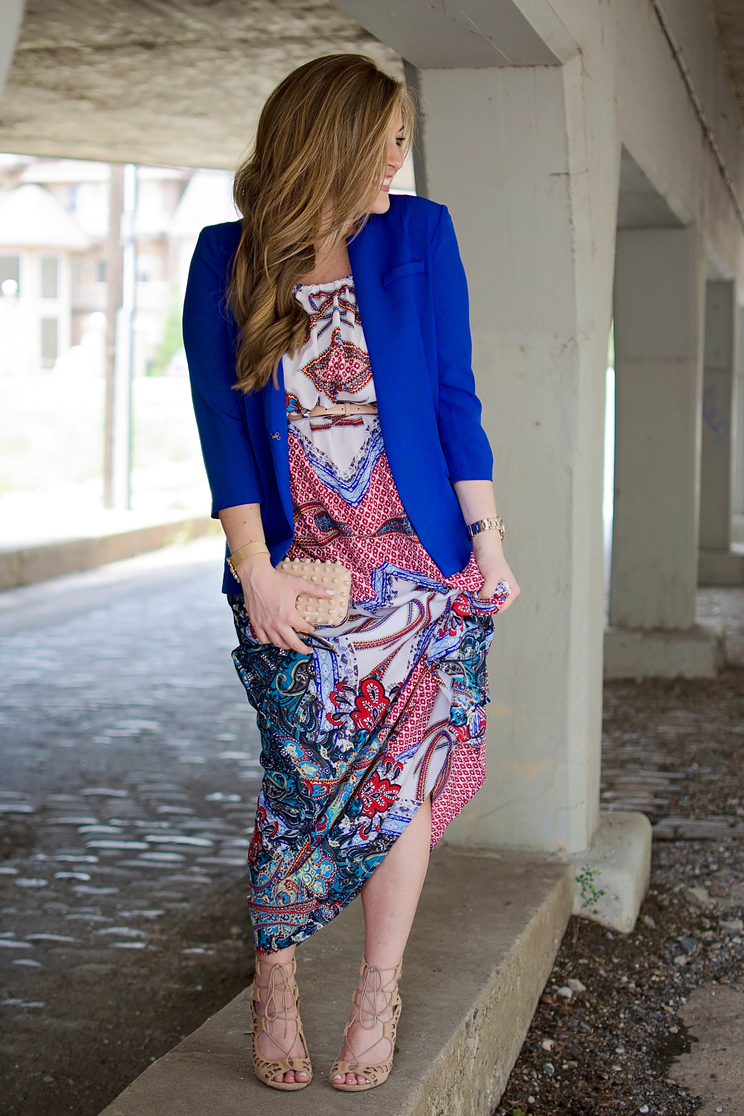 Laura B. wearing her lace up heels with a cute print maxi and bright blue blazer.