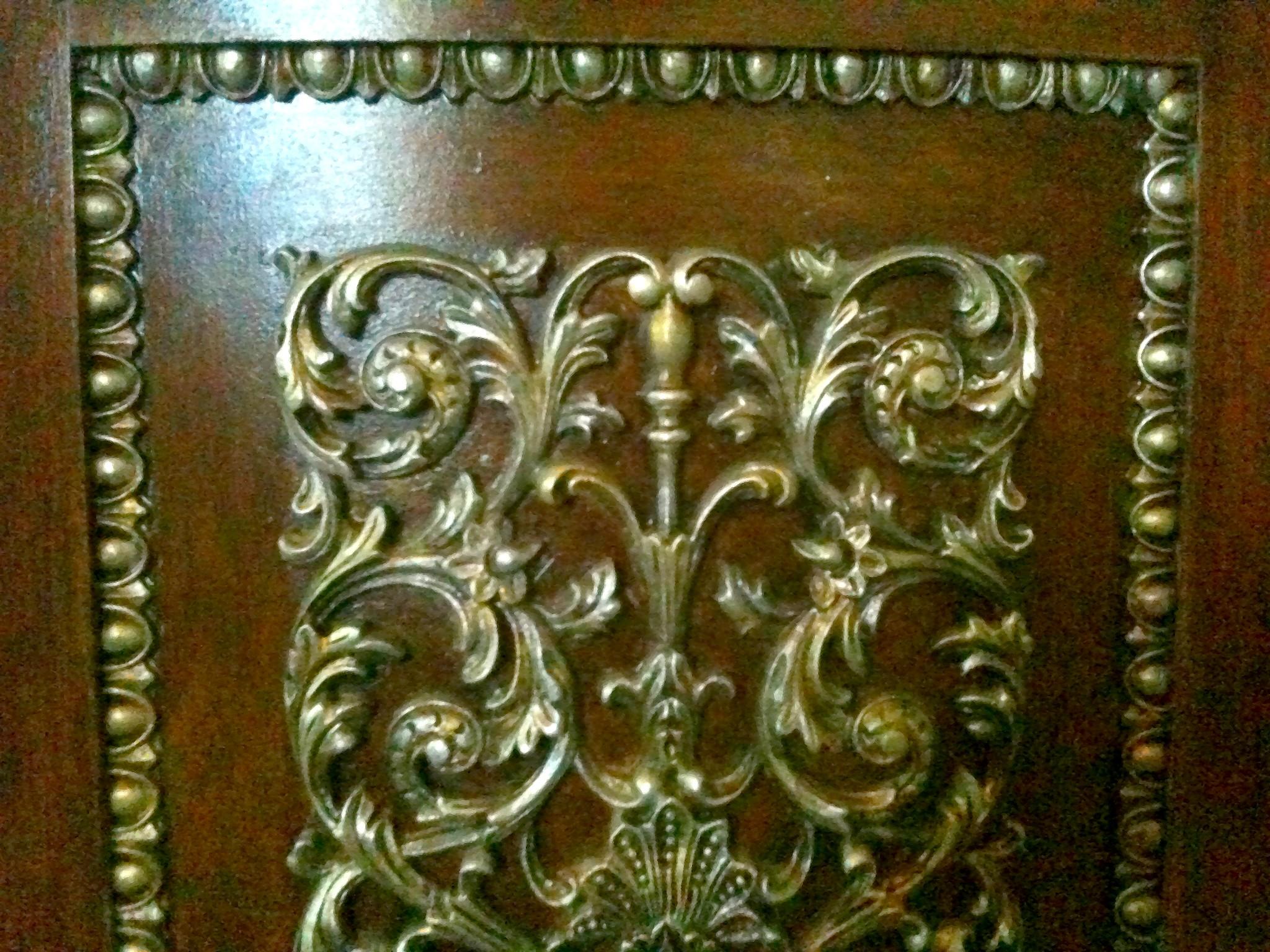Cabinet door with embellishments.