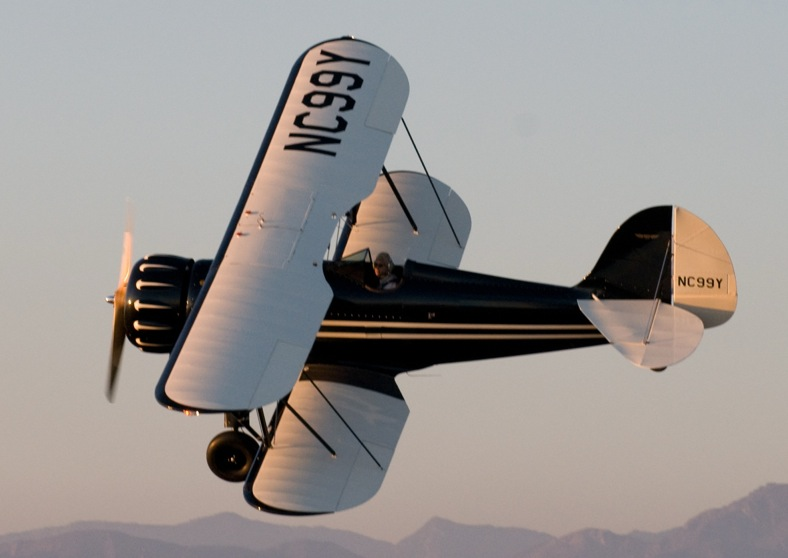 The B&W Biplane in flight over Hollywood.