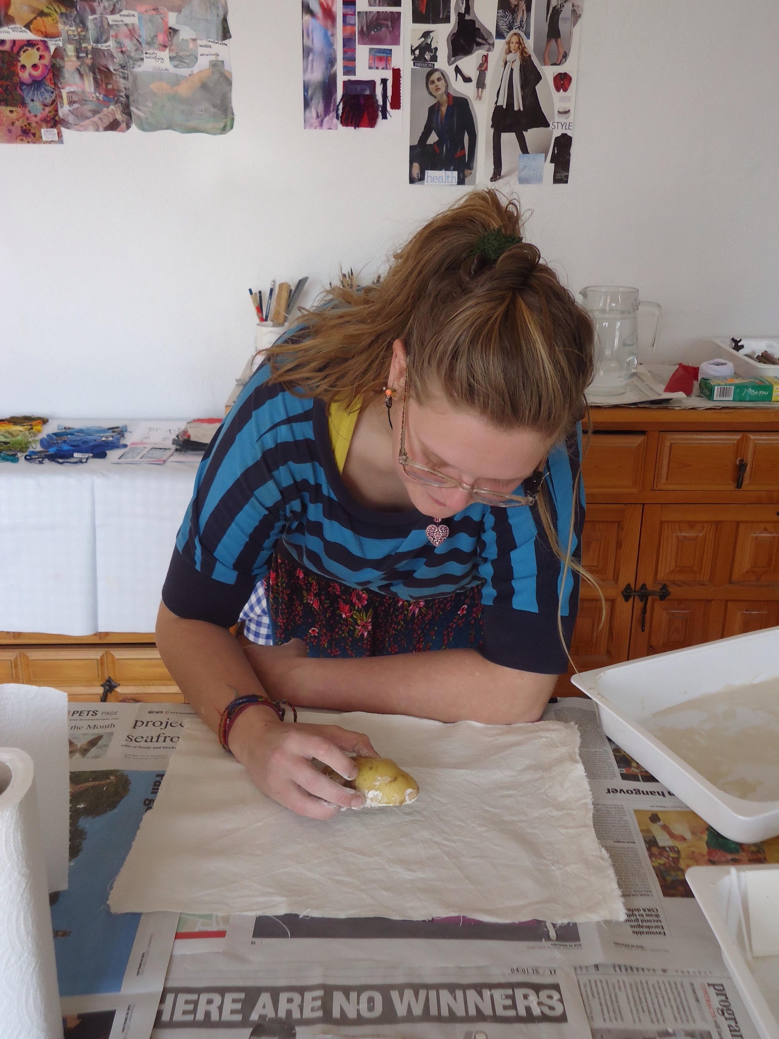 Applying the mud...using potato printing!