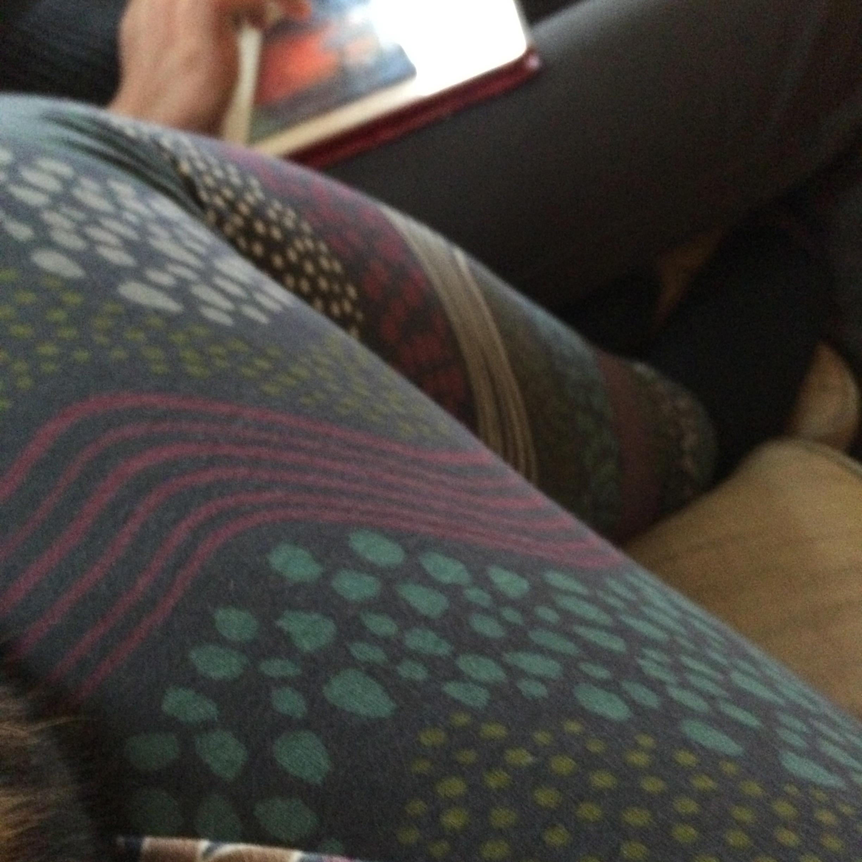 Gudrun Sjoden leggings curled up on the sofa