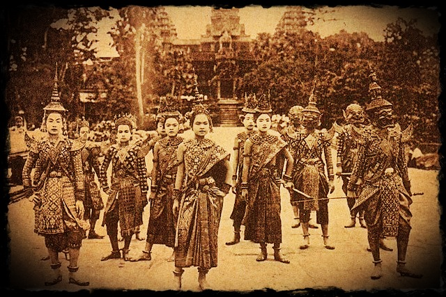 Antique photograph of traditional dance performers in front of Angkor Wat