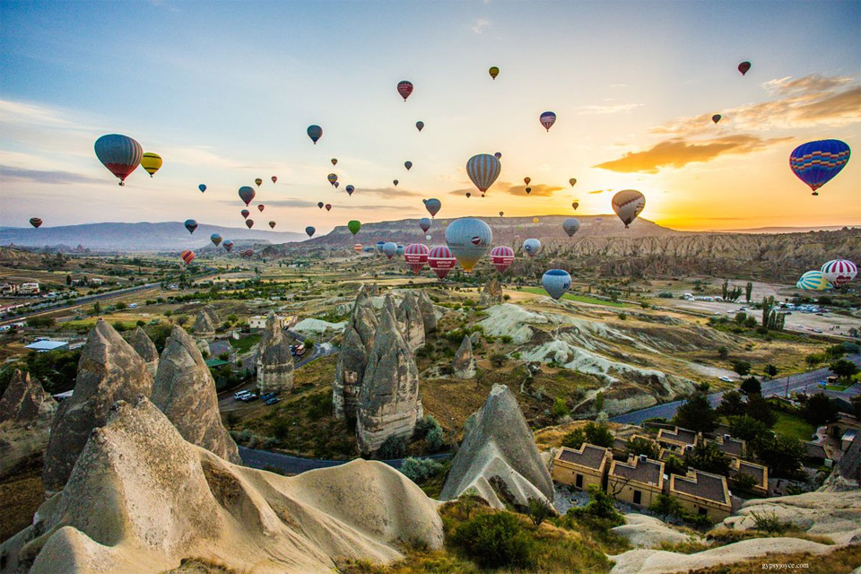 Colorful hot air balloons during sunrise