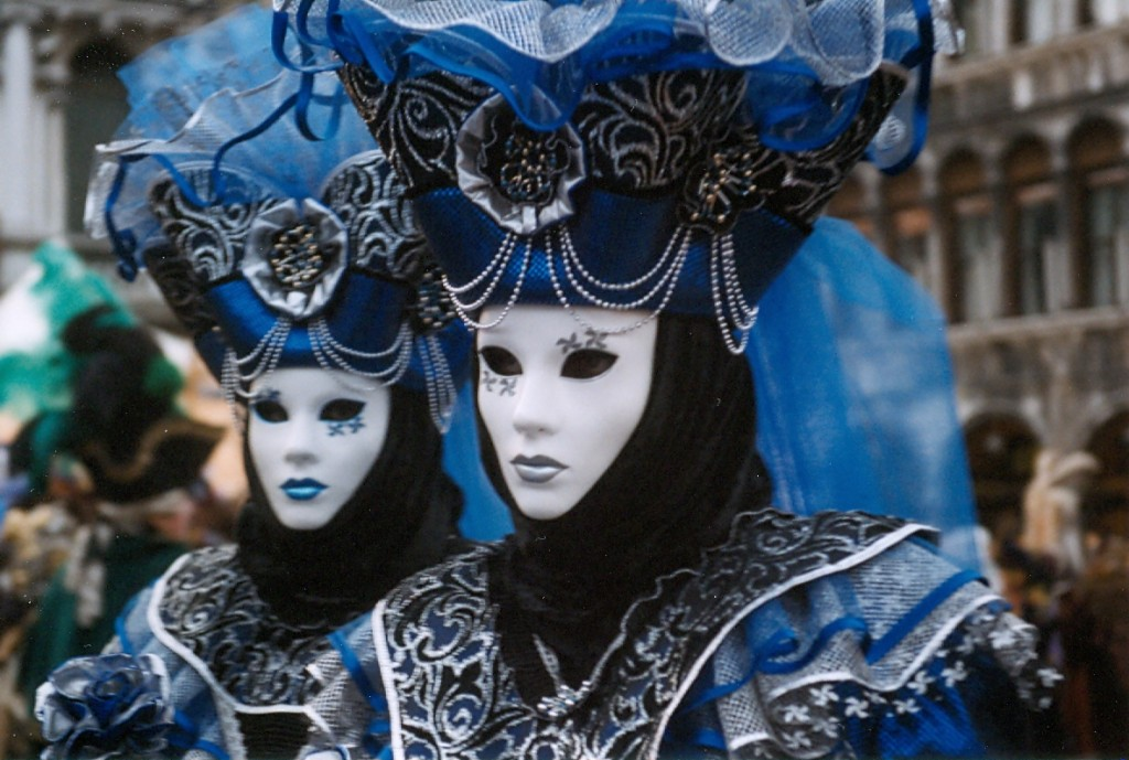 Revellers in elaborate costumes and masks