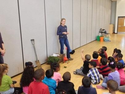Merideth Story talks to kids at Guilford Elementary on November 25, 2013.