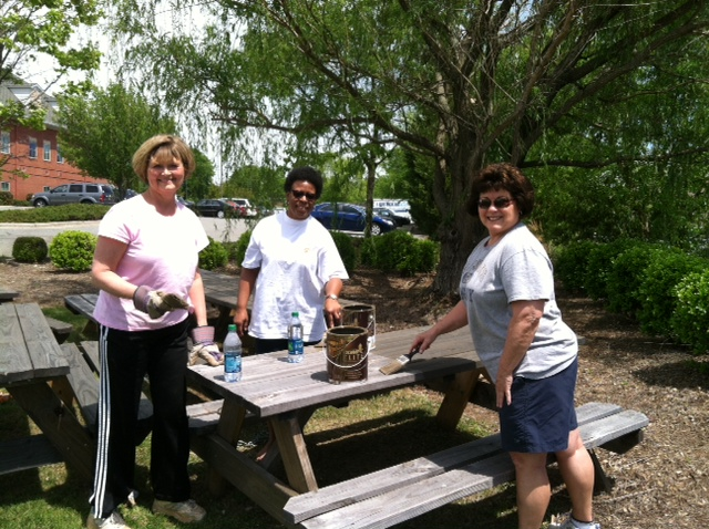 Volunteers from BB&T paint picnic benches.