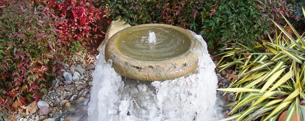 Concrete fountain in winter
