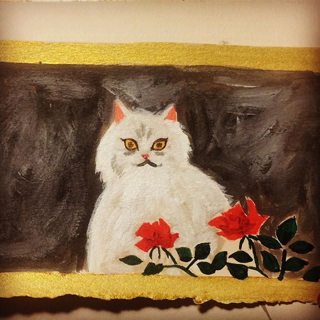 A miniature copy of the cat painting from House